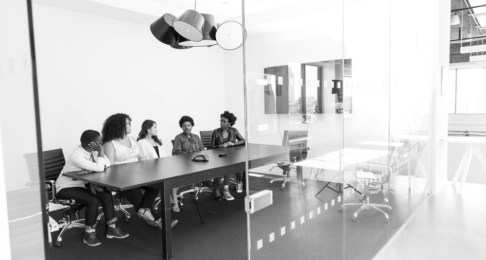 Business people in a boardroom behind a glass wall