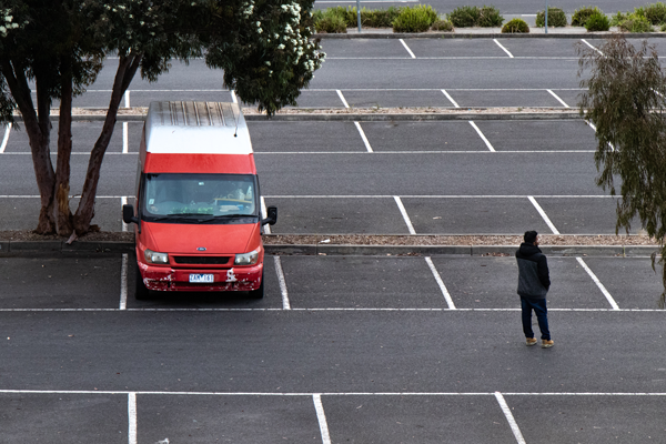 Van parked in an empty office car park