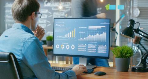 Man looking at a screen of big data