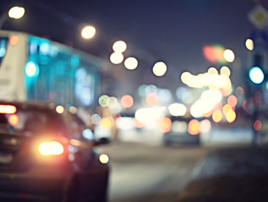 Blurred view of cars driving down the road