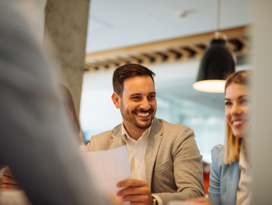 Man and woman laughing together in a meeting