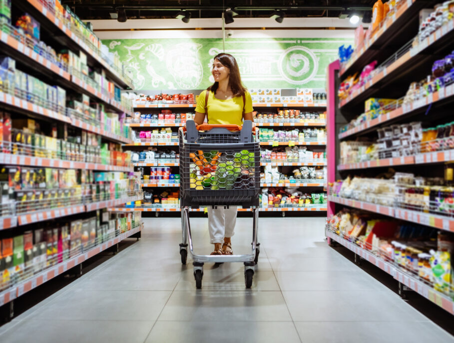 woman with shopping between store aisles