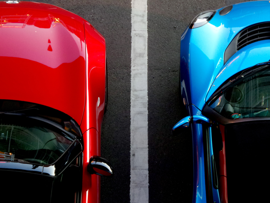An aerial shot of two cars parked in their parking spaces