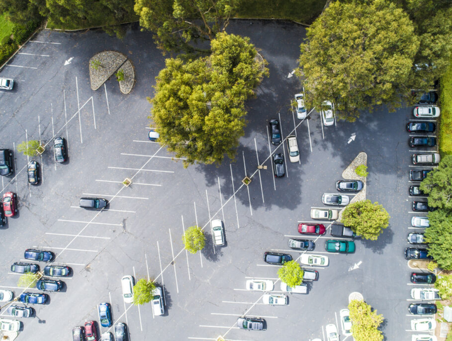 Aerial view of a half full car park