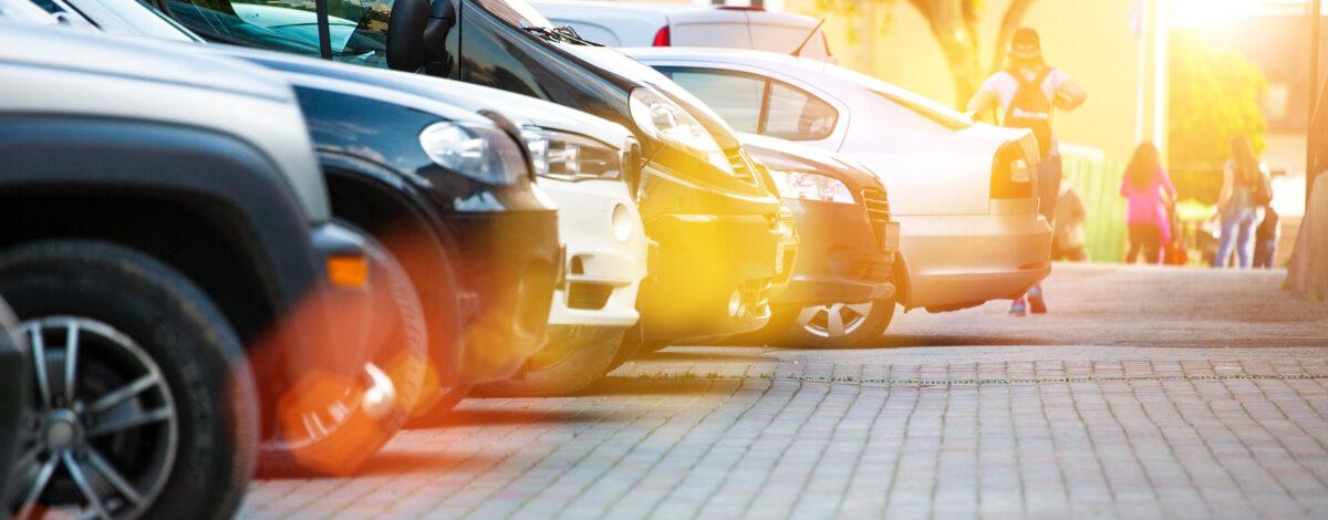 Multiple cars parked on a car park